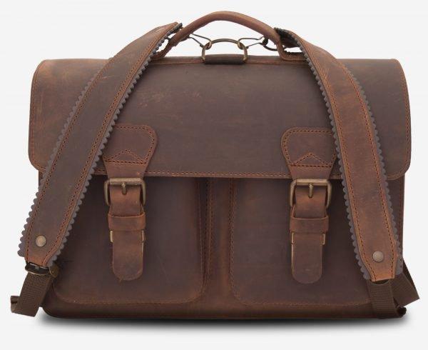 Cartable cuir bretelles vintage en cuir marron.