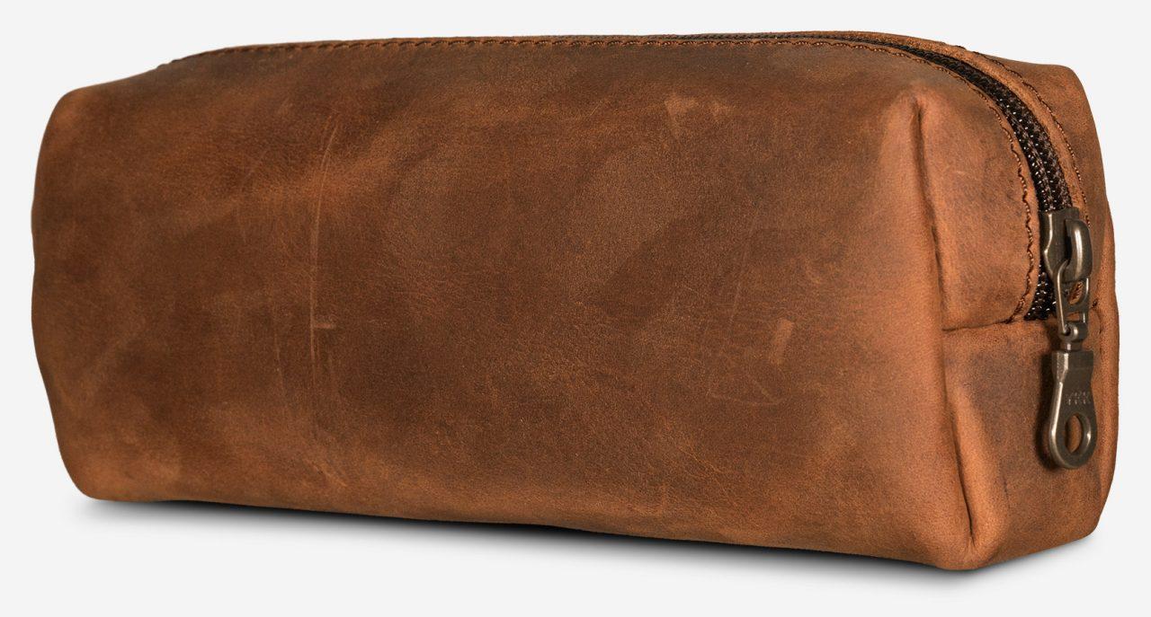 Trousse en cuir marron de dos.