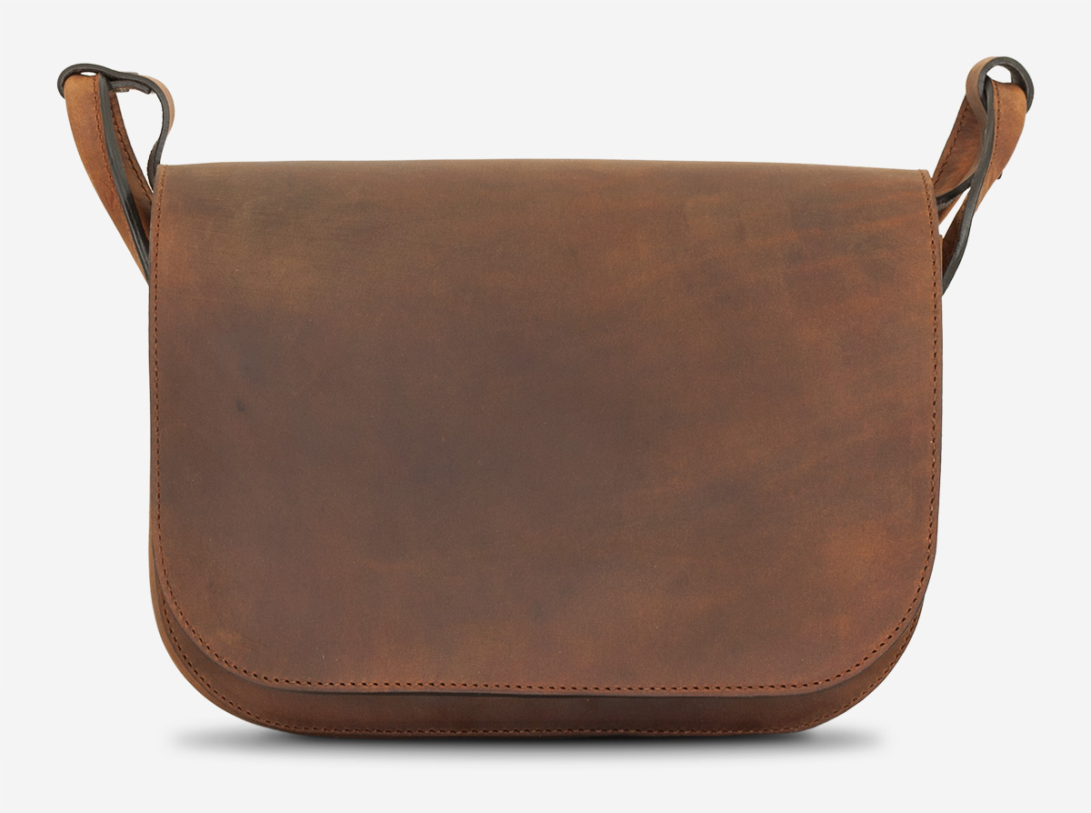 Besace artisanale en cuir marron.