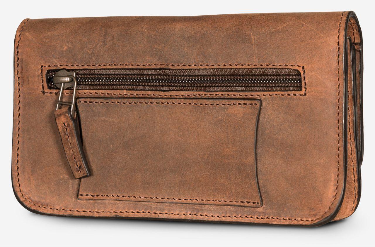 Sac ceinture en cuir marron pour homme.