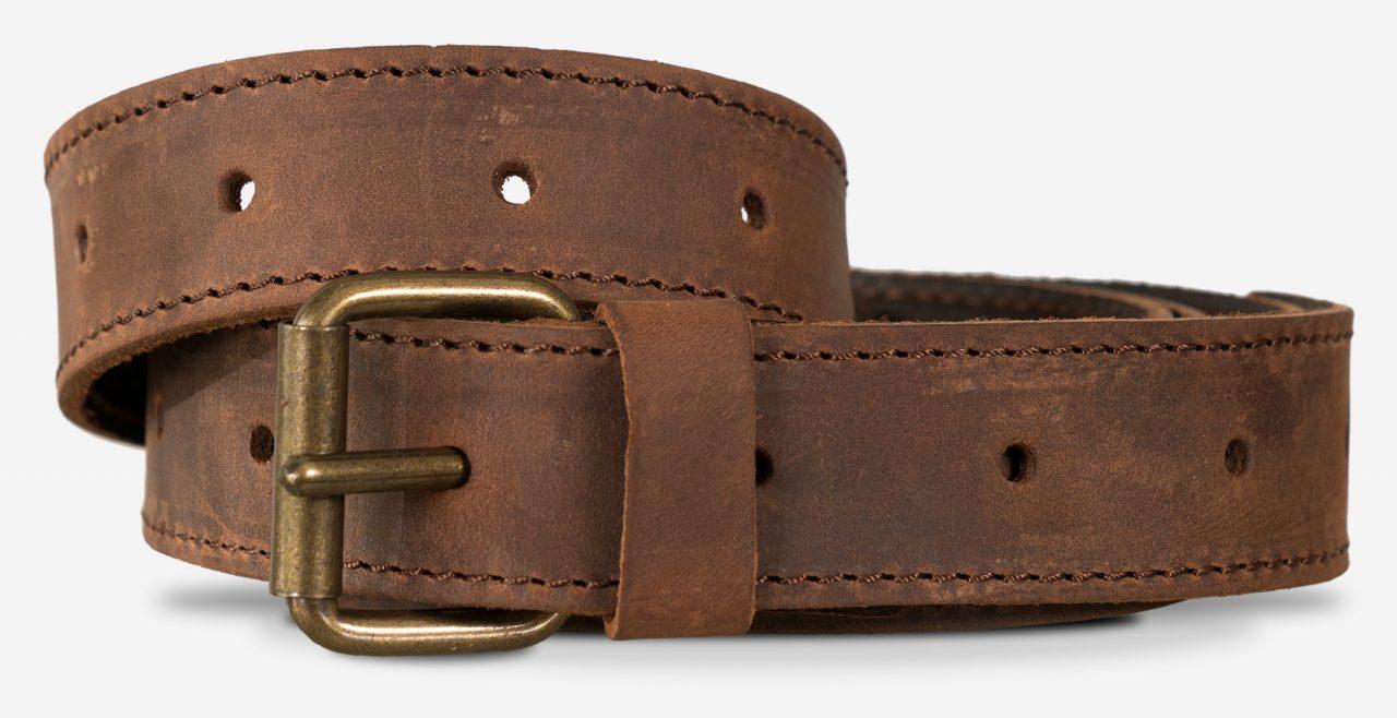 Bandoulière solide en cuir marron avec boucle à aiguille.