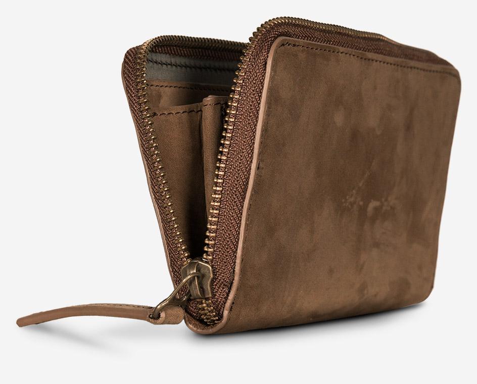 Portefeuille zippé en cuir pour homme.